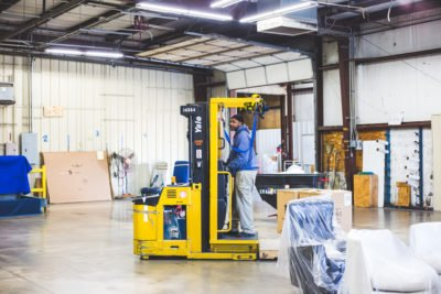 Arlan employee on forklift