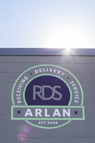 Arlan logo on building exterior